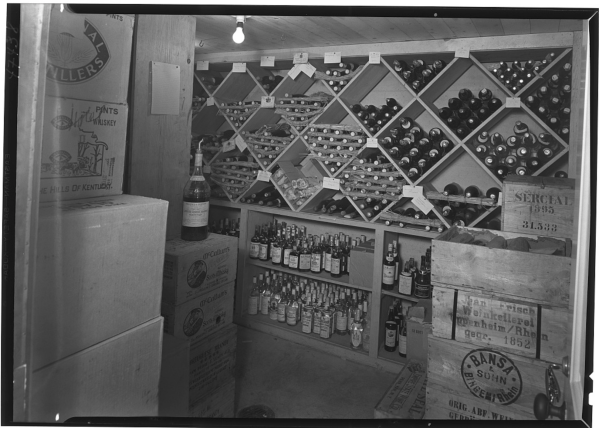 Black and White Photograph of wine in cellar
